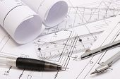 Rolled Electrical Diagrams And Accessories For Drawing Lying On Construction Drawing Of House. Drawi poster