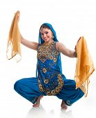 Bollywood dancer in traditional beautiful lblue dress performing with orange scarfs