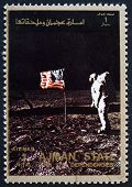 Postage stamp Ajman 1973 Aldrin Salutes U.S. Flag on the Lunar S