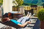 Relax In The Sun. Adult Woman Relaxing Resting In Deck Chair Outdoor On Veranda. Holiday Cottage. poster