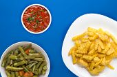French Fries On A White Plate In The Blue Background. French Fries With Vegetable Salad Fast Food To poster