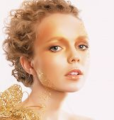 Styled Golden Woman's Face. Curly Hair. Professional Bronzed Makeup