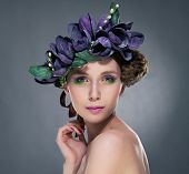 Charisma. Refined Shiny Brunette With Leaves And Flowers. Romance