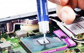 Applying Thermal Compound On Video Chip With Syringe Close View