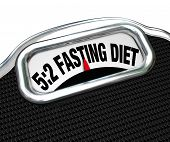 The words 5:2 Fasting Diet on a scale display to symbolize the new dieting fad or craze where you re