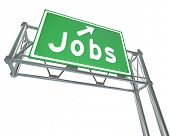 The word Jobs on a green freeway sign pointing you to open positions and a new career and employment