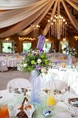 Laid Table With Flowers And Decorations At Wedding Reception