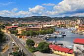 View on harbor with military navy base and city of La Spezia in Liguria, Italy.
