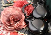 stock photo of castanets  - castanets and flowers on a background of a fan - JPG