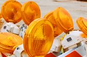 stock photo of flashers  - Traffic barricades with orange flashers - JPG