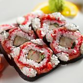 Roll with Smoked Salmon, Tamago (japanese omelet), Tobiko (flying fish roe) and Cucumber inside
