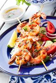 Prawn skewers with rice and vegetable salad