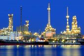 stock photo of greenpeace  - Oil refinery at twilight Chao Phraya river Thailand - JPG