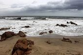 stock photo of beachfront  - Picture of Beachfront in Stormy Weather with Sharp Rocks - JPG