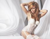 stock photo of corset  - Beautiful bride in lingerie isolated on white - JPG