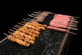Photo of Barbecue skewers on the grill