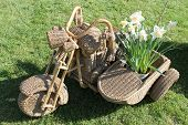 stock photo of sidecar  - nice wicker sidecar manufadturing in the garden - JPG