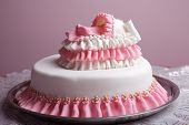 stock photo of fancy cakes  - Birthday cake with mastic and little baby in bed - JPG