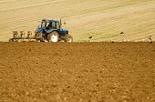 Farmer Ploughing Field For Next Crop.