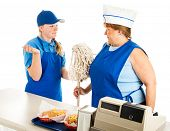 Adult woman working at a fast food job has to take orders from a teenage boss.  Isolated on white.