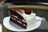 picture of tort  - Black Forest Cake on the glass table - JPG