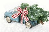 Blue Toy Truck Carrying A Christmas Tree
