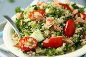 stock photo of cereal bowl  - Tabbouleh salad with quinoa salmon tomatoes cucumbers and parsley