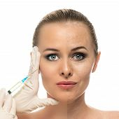 Cosmetic injection to the pretty Beautiful woman face and beautician hands with syringe.