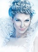 Beautiful sexy, glamorous girl with wings in an image of the fairy of winter