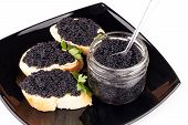 Small Sandwiches With Black Caviar On Dark Plate