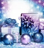 Photo of silver Christmas presents on falling snowflake background, different gift box wrapping in s