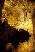 Tourists Inside  Stalactites Cave Looking Infernal