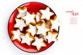 Christmas Cinnamon Star Cookies On Red Plate
