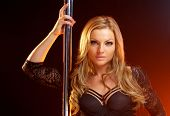 Portrait Of A Beautiful Blond Woman With Dance Pole