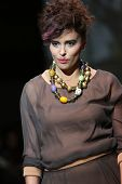 ZAGREB, CROATIA - NOVEMBER 22: Fashion model wearing clothes designed by Iggy Popovic on the Zagreb Fashion Week show on November 22, 2013 in Zagreb, Croatia.