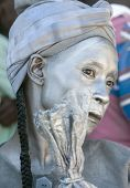 Haitian Woman Painted in Silver