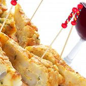closeup of a plate with typical spanish pincho de tortilla, spanish omelete served on bread