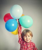 Child holding the bunch of balloons