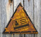 ID Card Icon on Rusty Warning Sign.