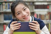 Student Resting Her Chin On Textbook