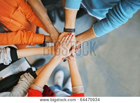 Group Of Young People Stacking Their Hands poster