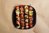 stock photo of kababs  - Stock image of grilled beef and chicken kebabs - JPG