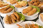 Deep Fat Fried Food Assortment In Plates On Cafe Shop Shelf