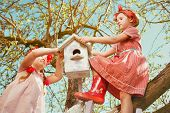Children installing a self-made Bird House.