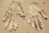 The arm print of  bride and groom on sand