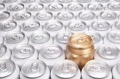Group of Aluminum Beverage Cans with One Gold Can