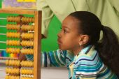 A Teacher Showing How To Use A Abacus