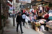HONG KONG - NOVEMBER 14, 2012: Trading pedestrian Wing Kut Street (Sheung Wan) is a popular destinat