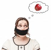 picture of gag  - Gagged beautiful brunette plus size woman dreaming about apple isolated - JPG