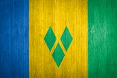Saint Vincent And The Grenadines Flag On Wood Background